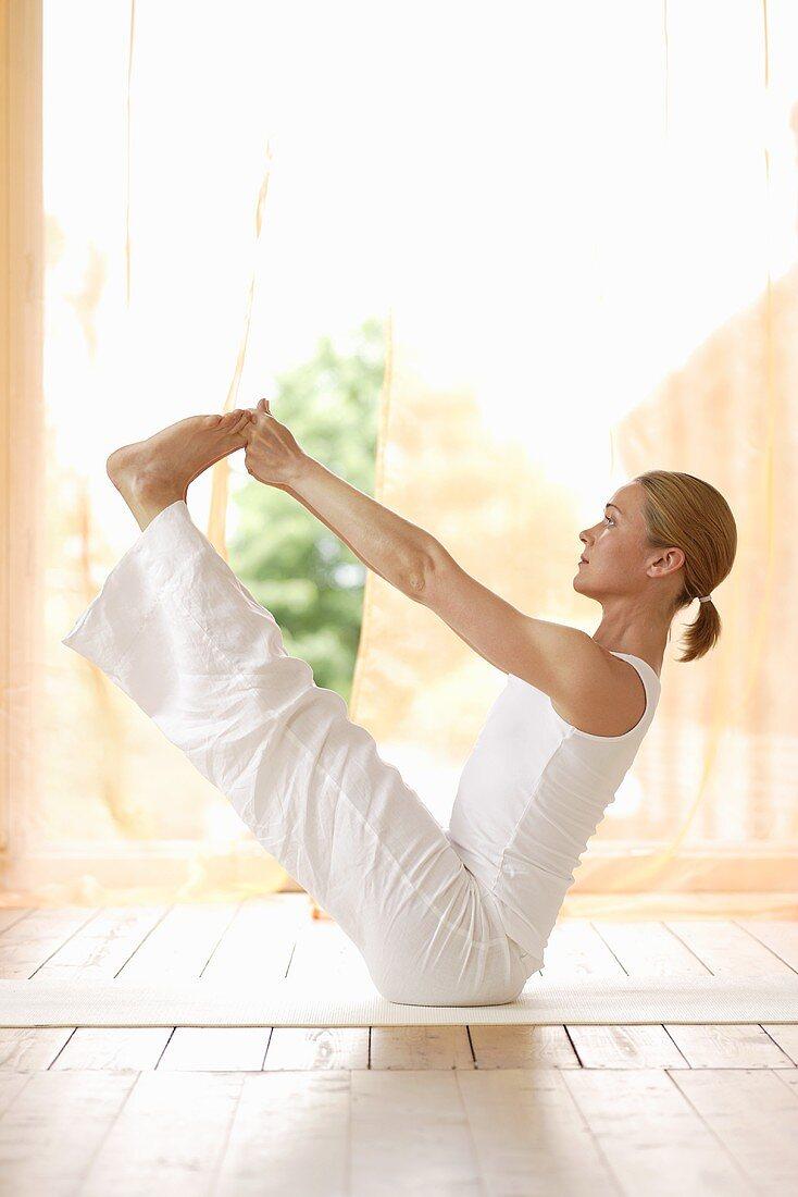 Yoga posture: Ubhaya Padangusthasana (Both Big Toes Pose)