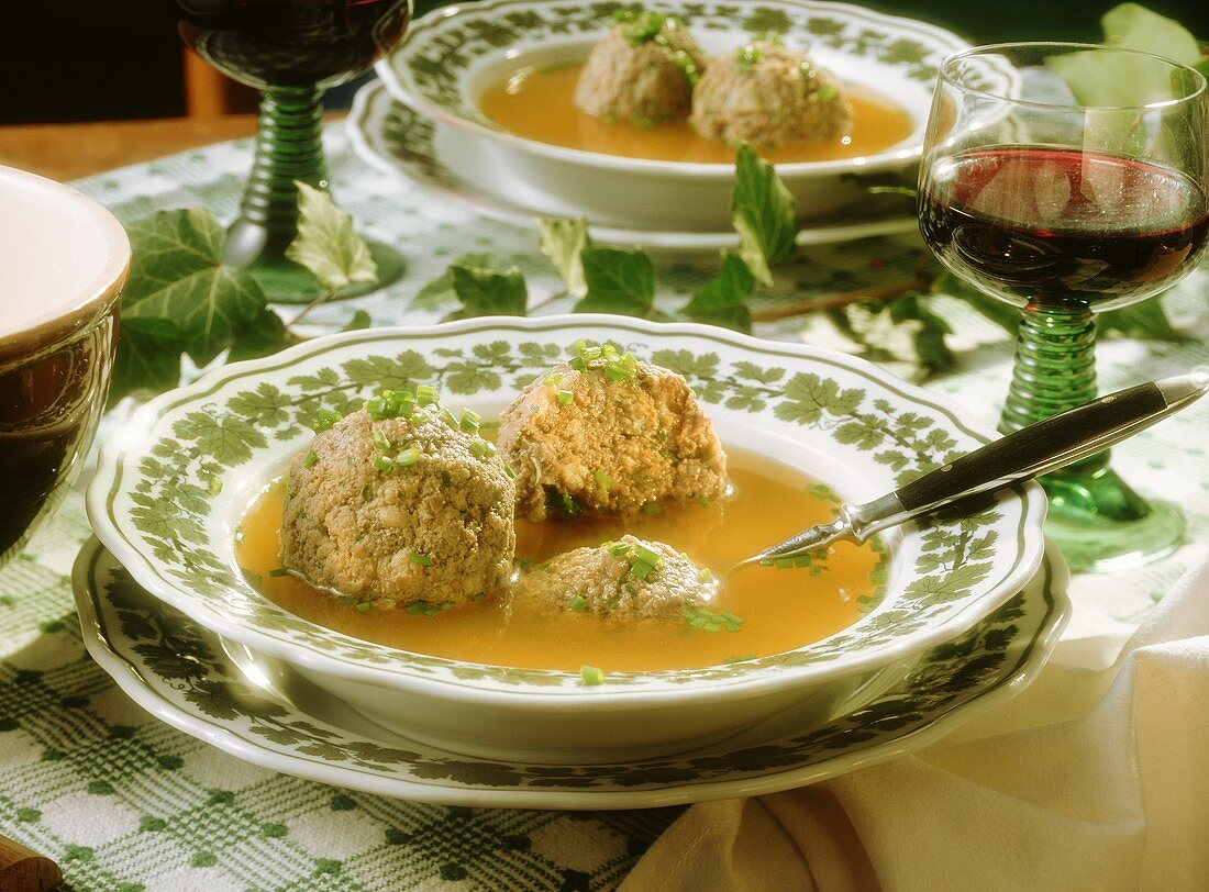 Liver Dumpling Soup; Red Wine in a special Glass