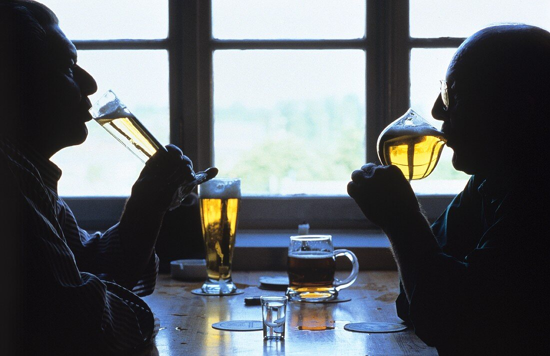 Two men drinking Pils in pub