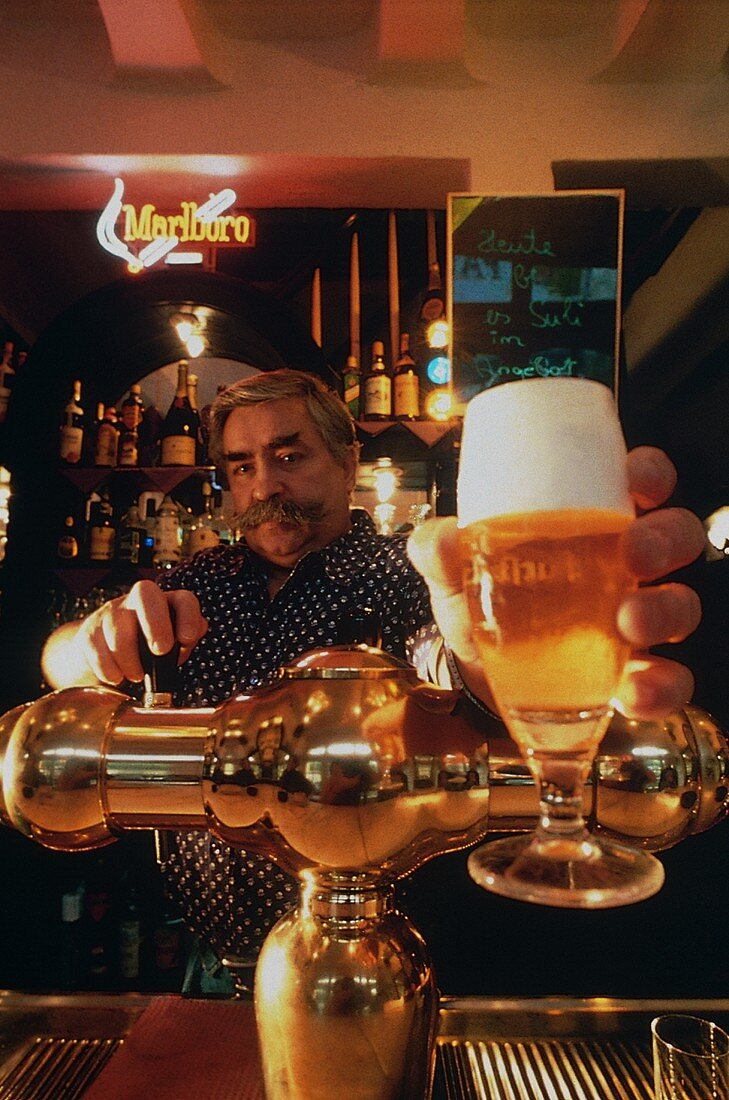 Waiter Behind Counter with Pilsner