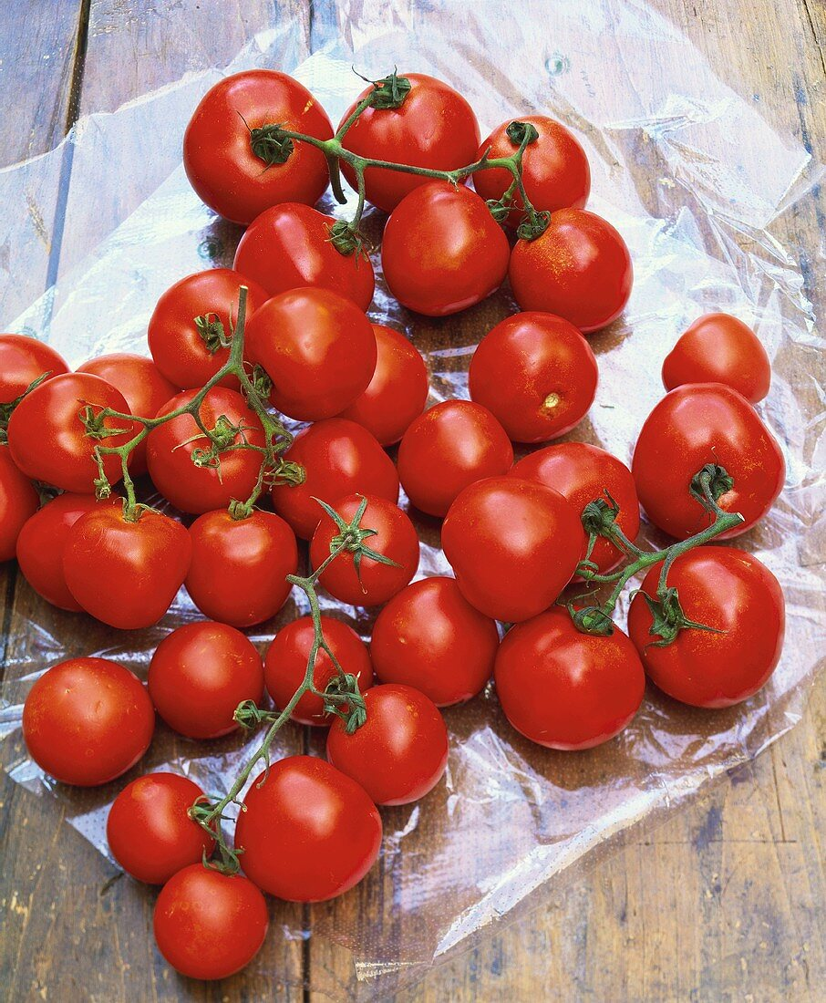 Fresh cherry tomatoes on cellophane paper
