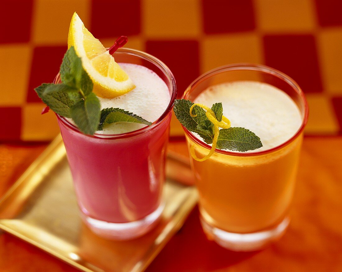 Yoghurt and lemon frappés in coloured glasses