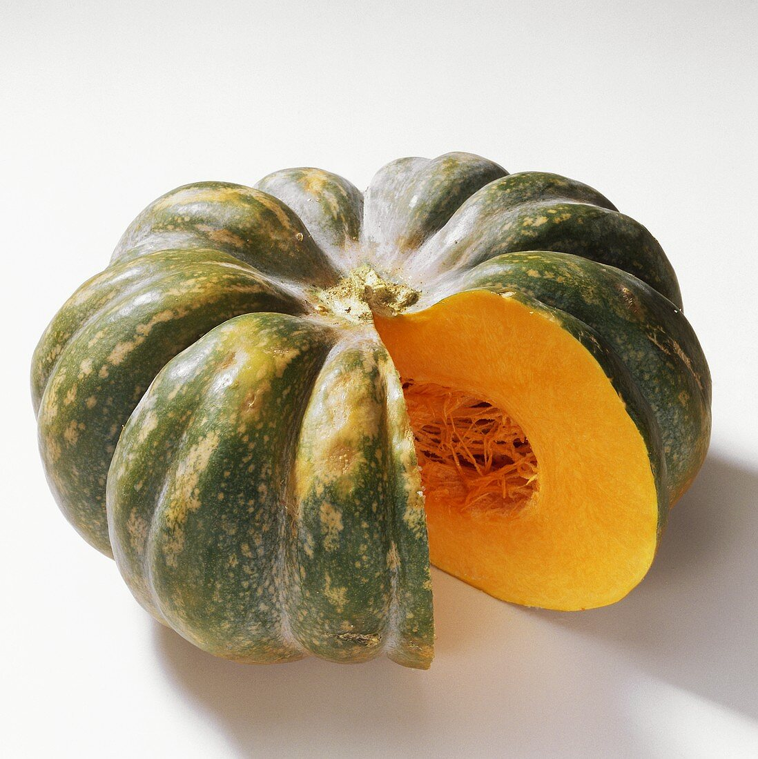 Winter squash (Cucurbita moschata), a piece cut off