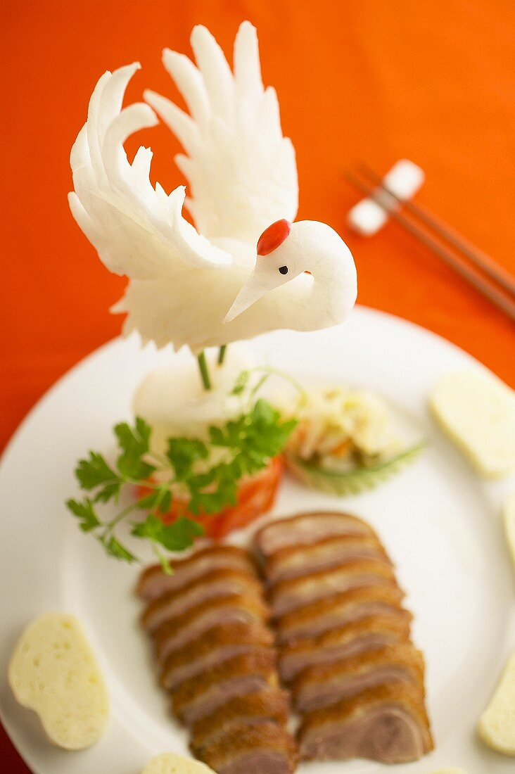 Roast duck breast with food carving (crane)