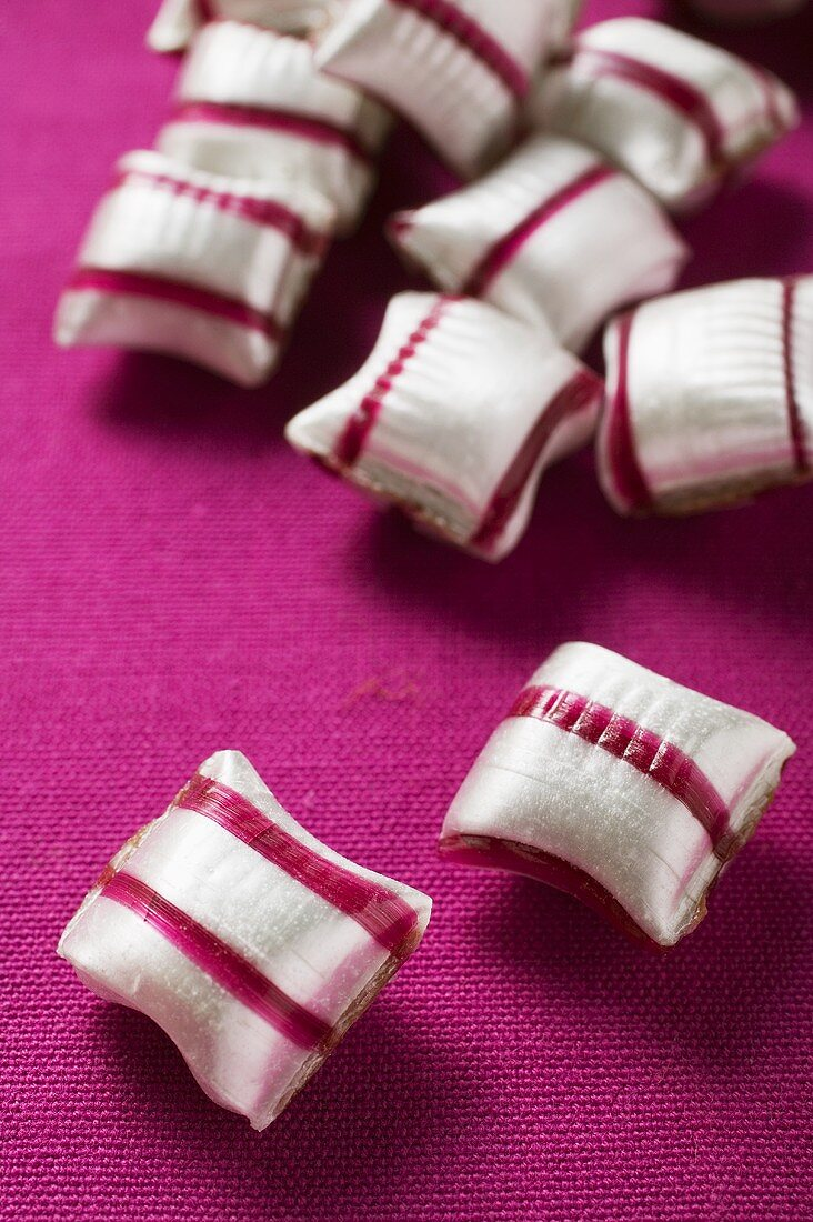 Cherry mint sweets on purple background