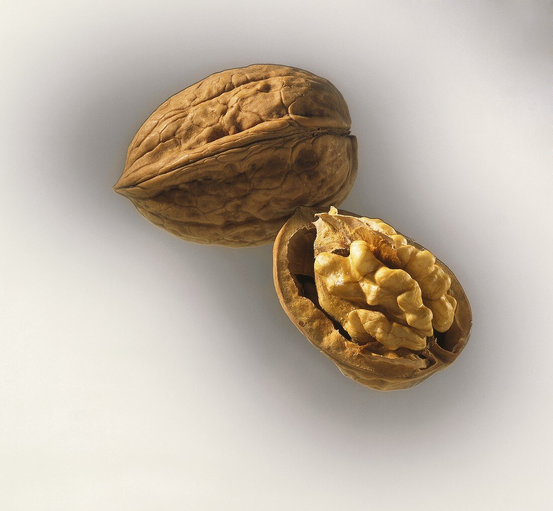 Walnuts, with intact and opened shell
