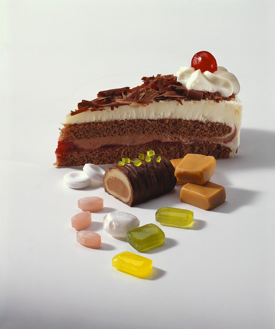 Slice of Black Forest gateau and assorted sweets