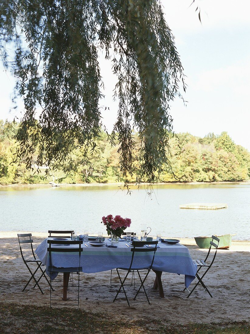 Laid table beside water