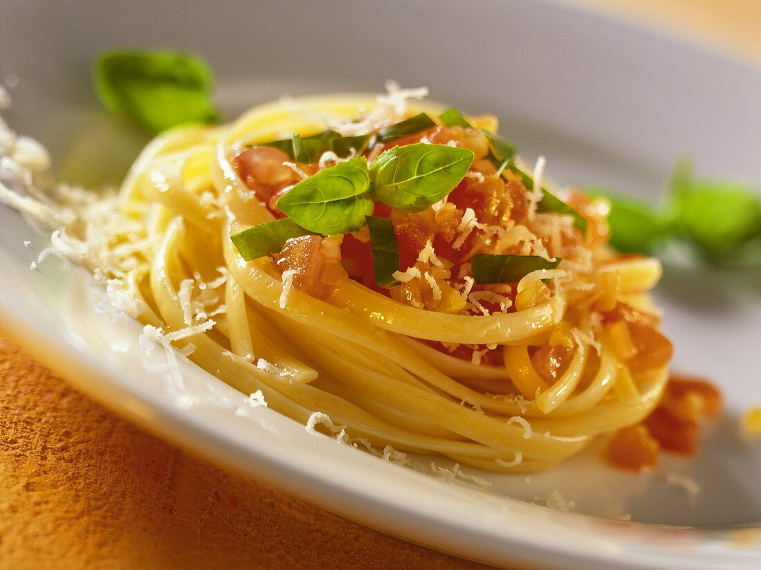 Pasta with tomato sauce, basil and Parmesan