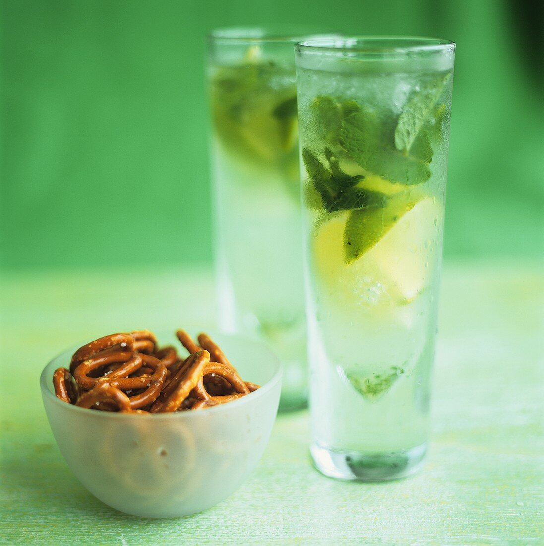 Two glasses of Mojito and salted pretzels