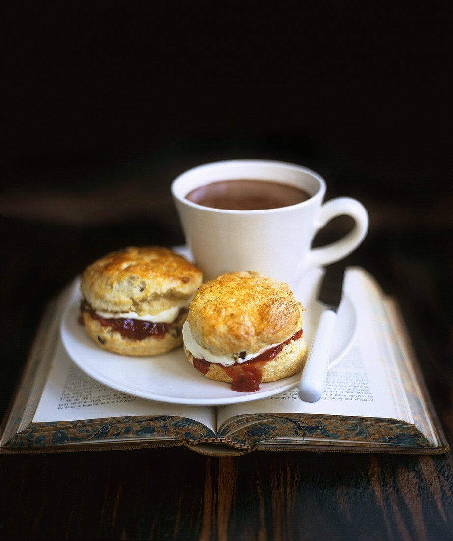 Scones with jam and cream and hot chocolate