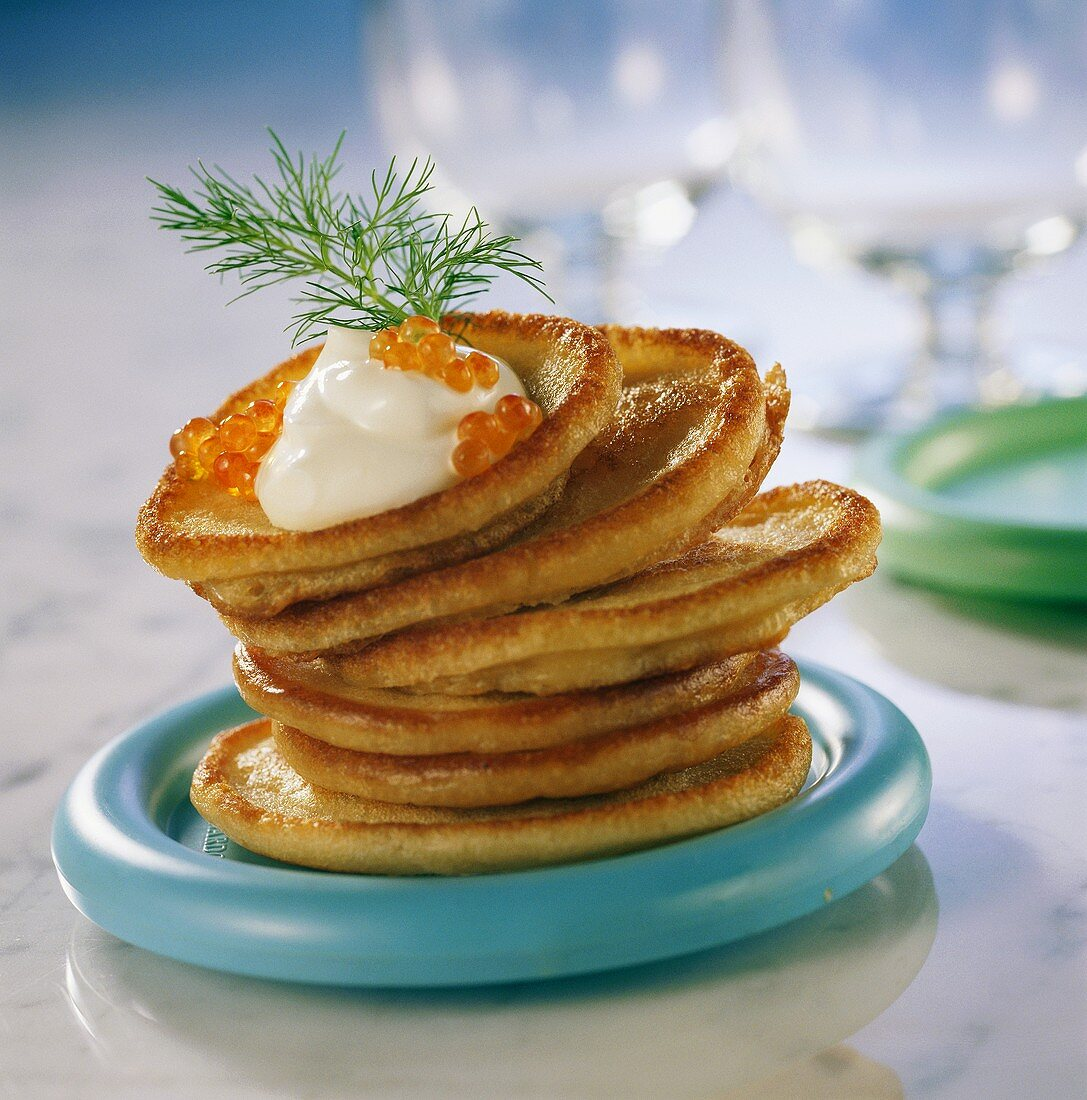 Blinis with sour cream and caviare