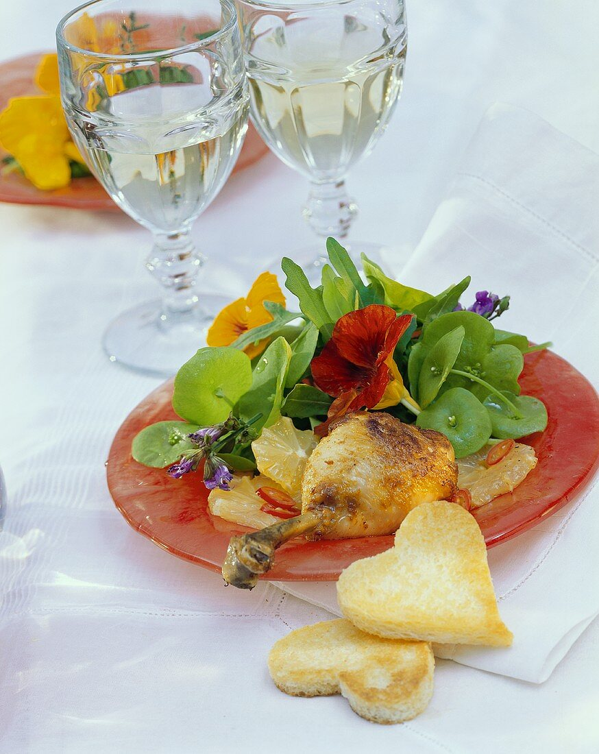 Chicken leg with watercress salad and heart-shaped toast
