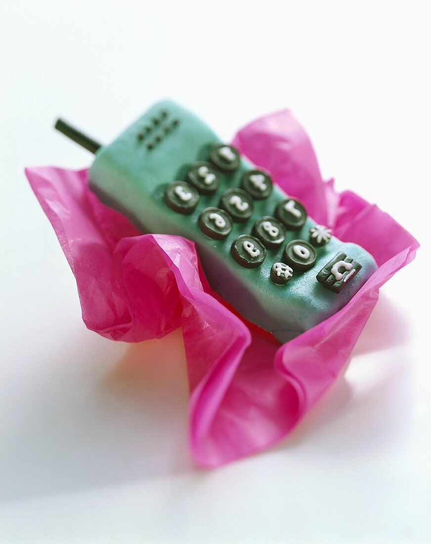 Cake with marzipan & liquorice in shape of mobile phone