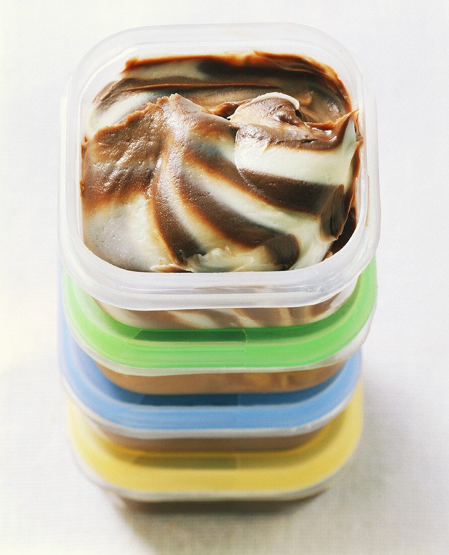 Chocolate and vanilla ice cream in food storage boxes
