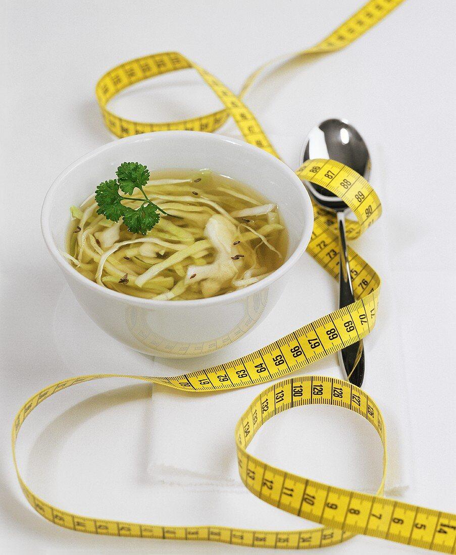 Picture symbolising Magic Soup Diet: cabbage soup & tape measure