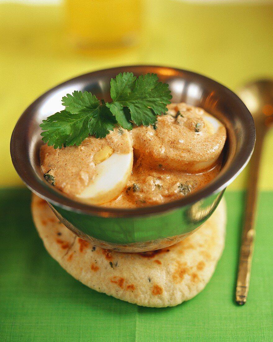 Hard-boiled eggs in Mughlai sauce (India)