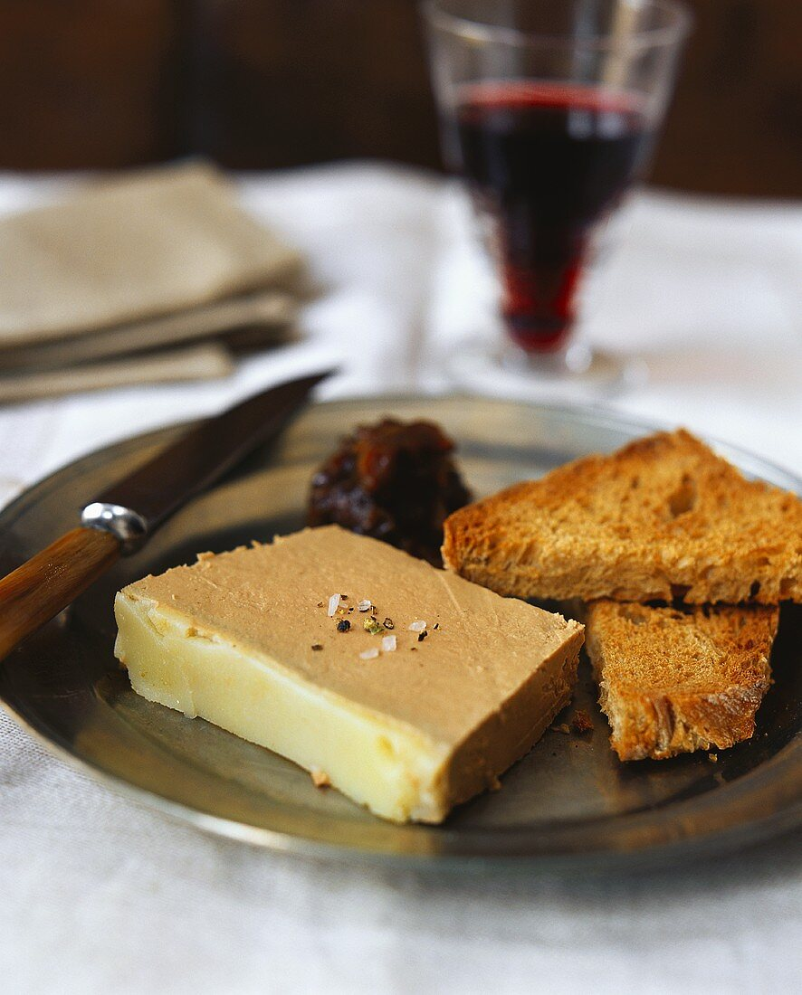 A slice of chicken liver pâté with toast triangles