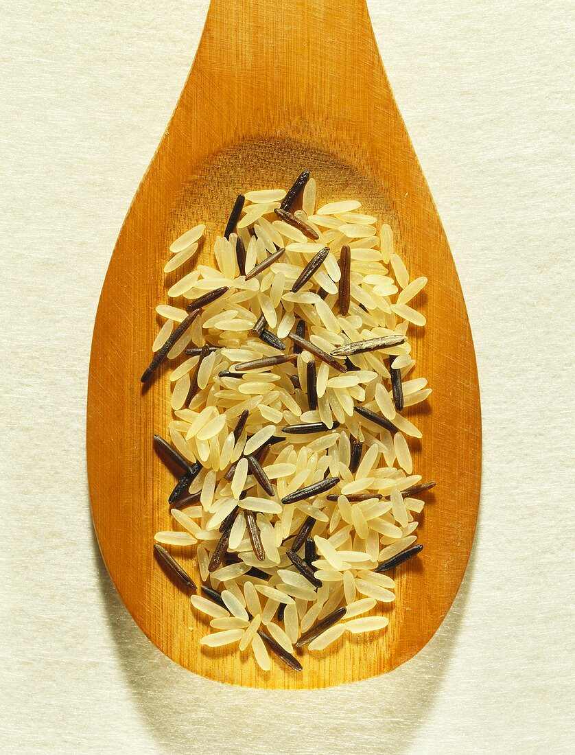 Wild rice and parboiled rice on wooden spoon