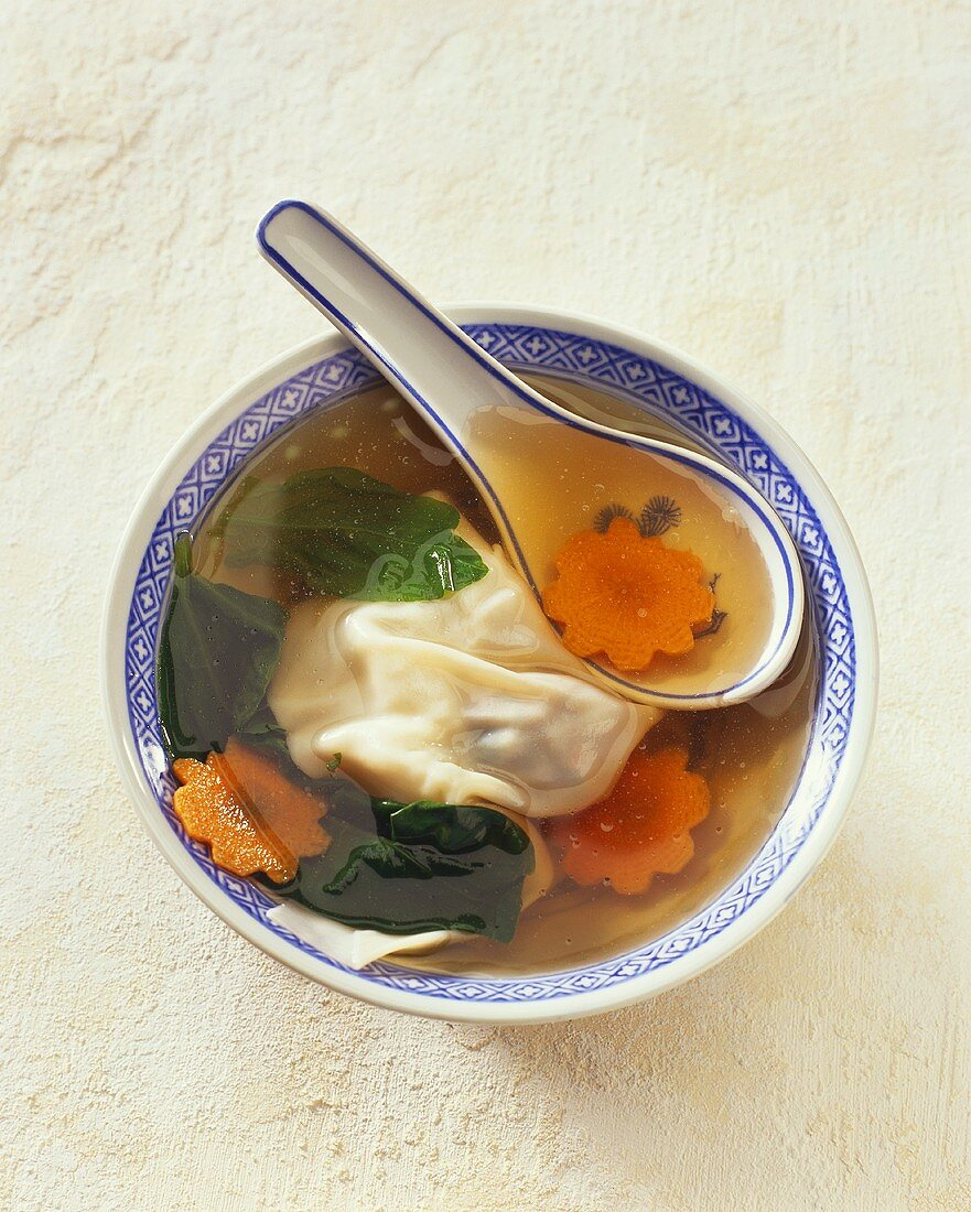Clear broth with vegetables and won ton (Asia)