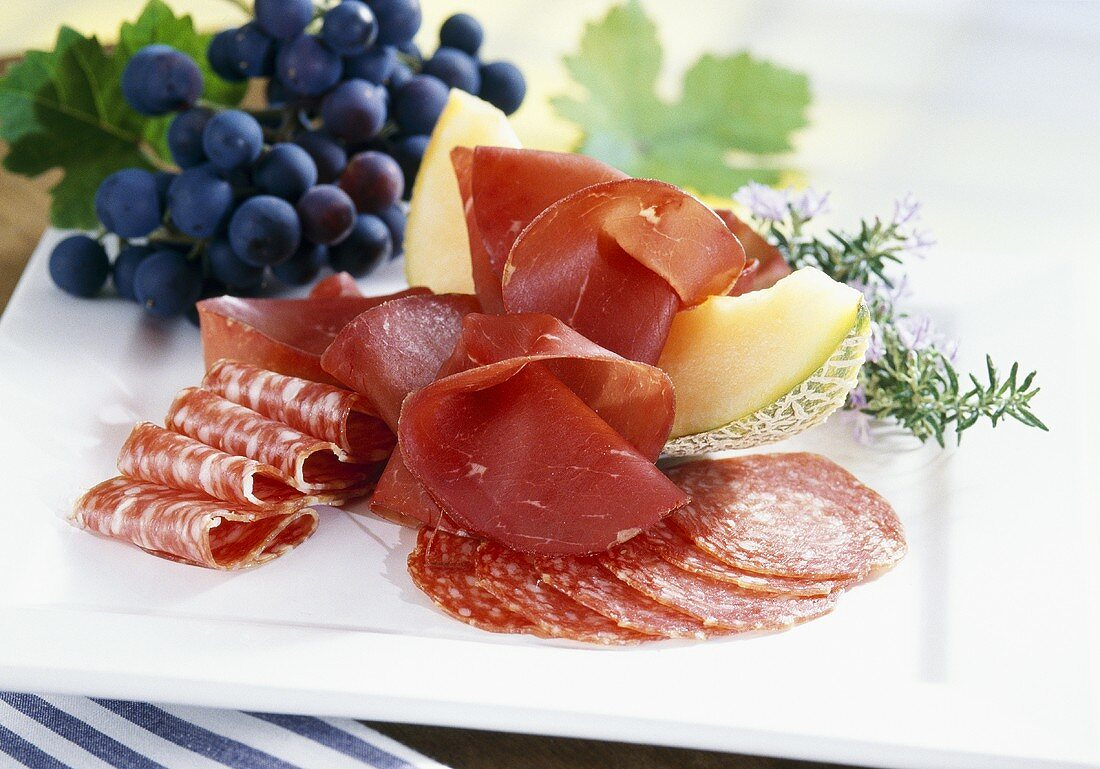 Bresaola (Italian air-dried beef), salami and fruit