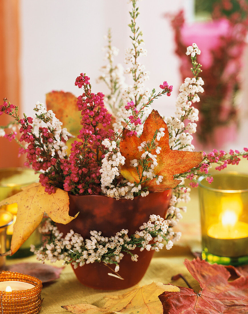 Arrangement of heather and autumn leaves