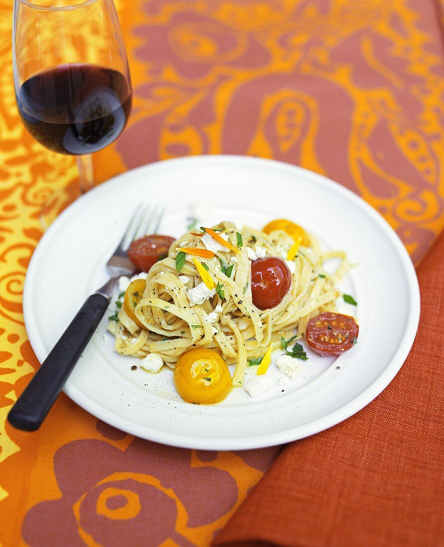Tagliatelle with cherry tomatoes and goat's cheese