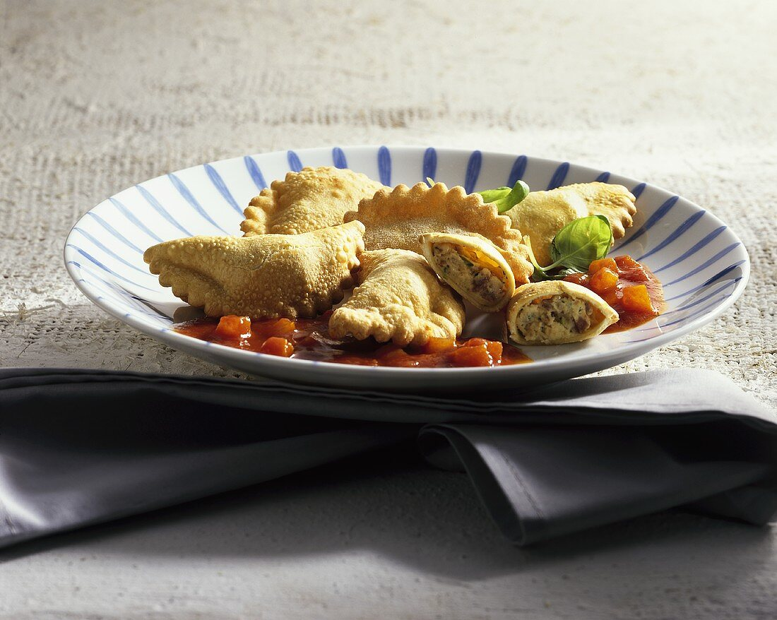 Deep-fried ricotta parcels with tomato sauce