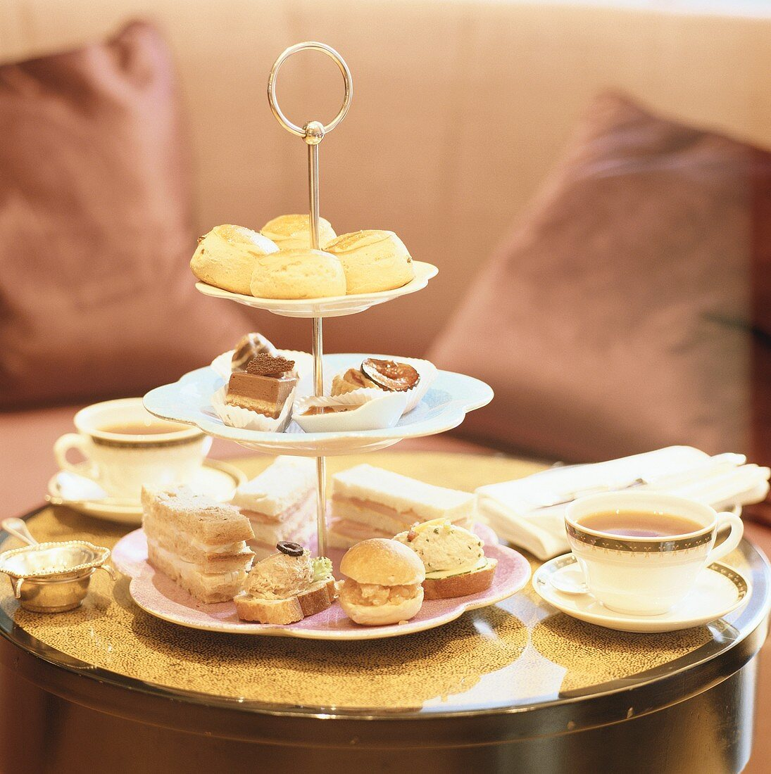 Tiered stand with cakes and snacks to serve with tea