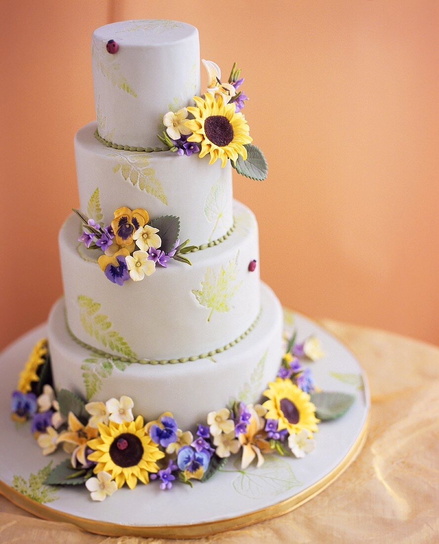 Multi-tiered marzipan cake with flower decoration