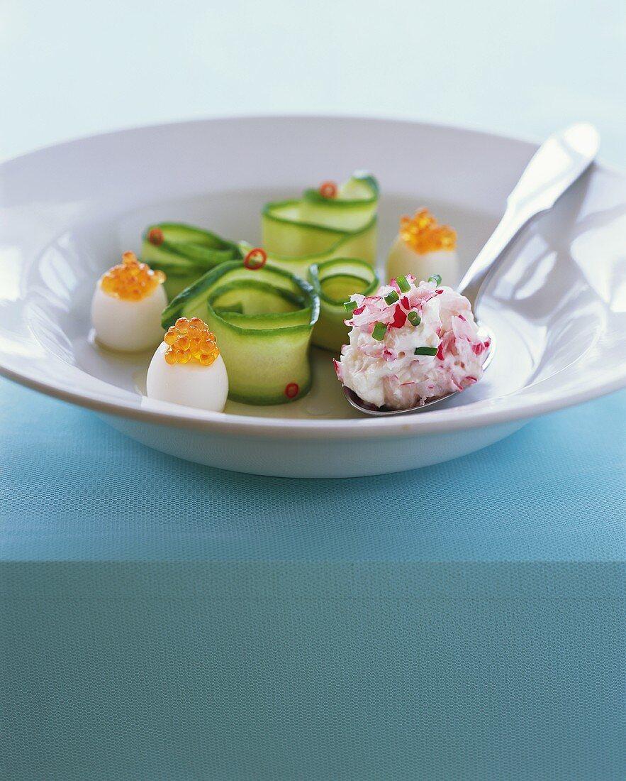 Quails' eggs with salmon caviare, courgette rolls & radish dip