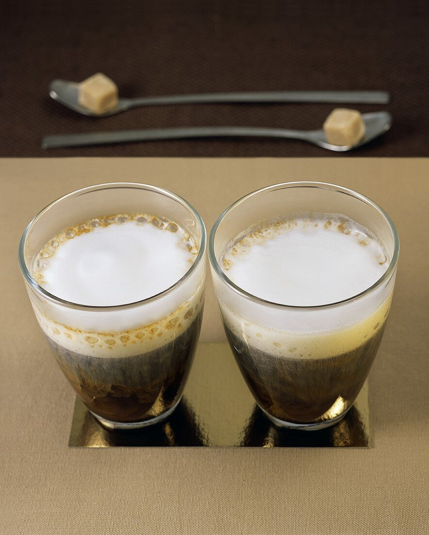 Coffee with milk froth and brown sugar