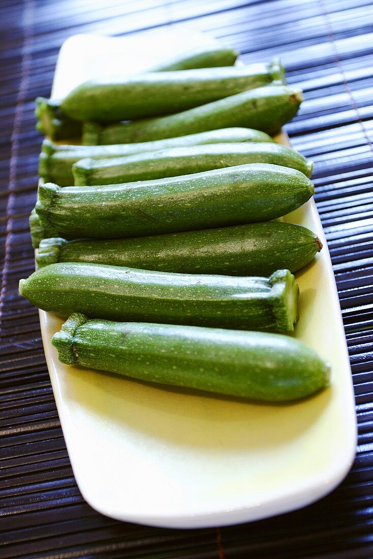 Several courgettes in a bowl