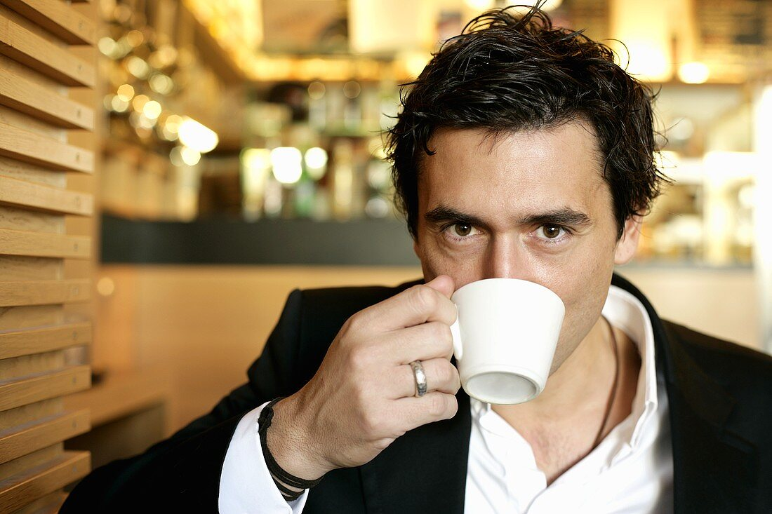 Man drinking cappuccino