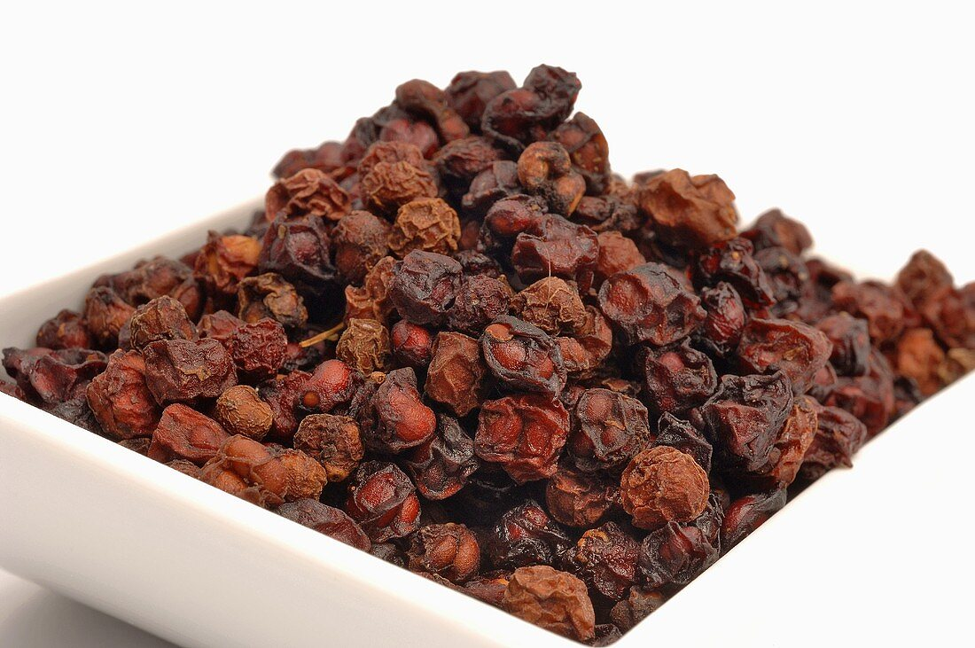 Dried schisandra berries in a small bowl