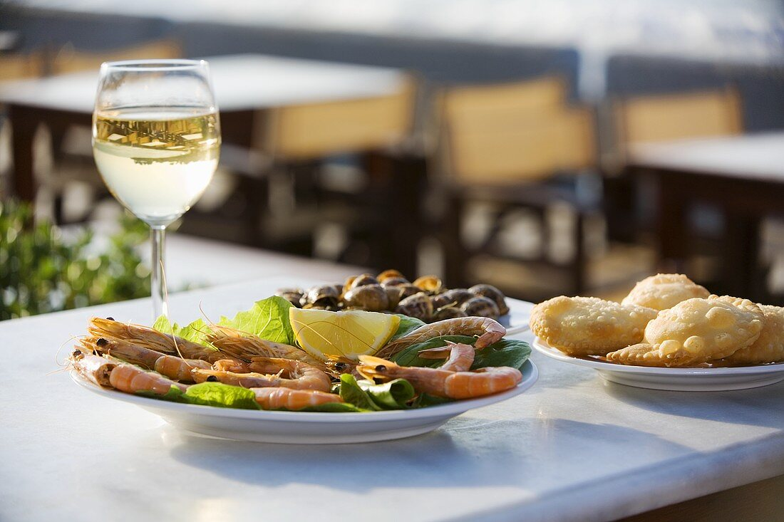 Shrimps, snails, white wine and cheesy pastries
