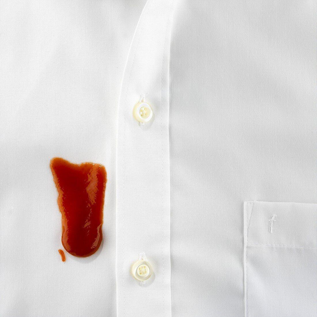 Blob of ketchup on white shirt