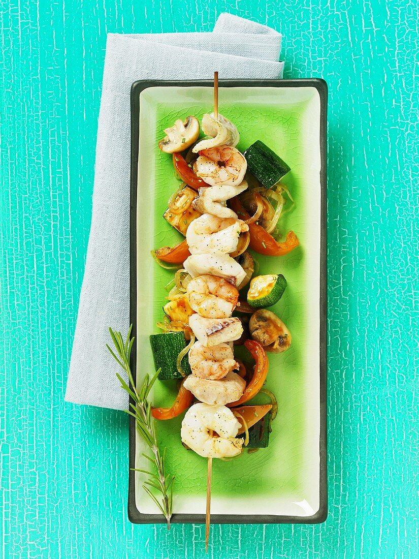 Skewered shrimp and fish on a bed of vegetables