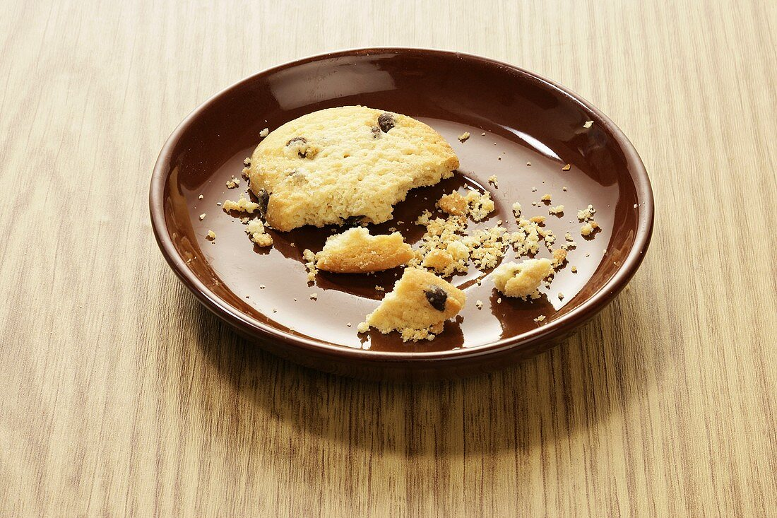 Broken chocolate chip cookie on a plate