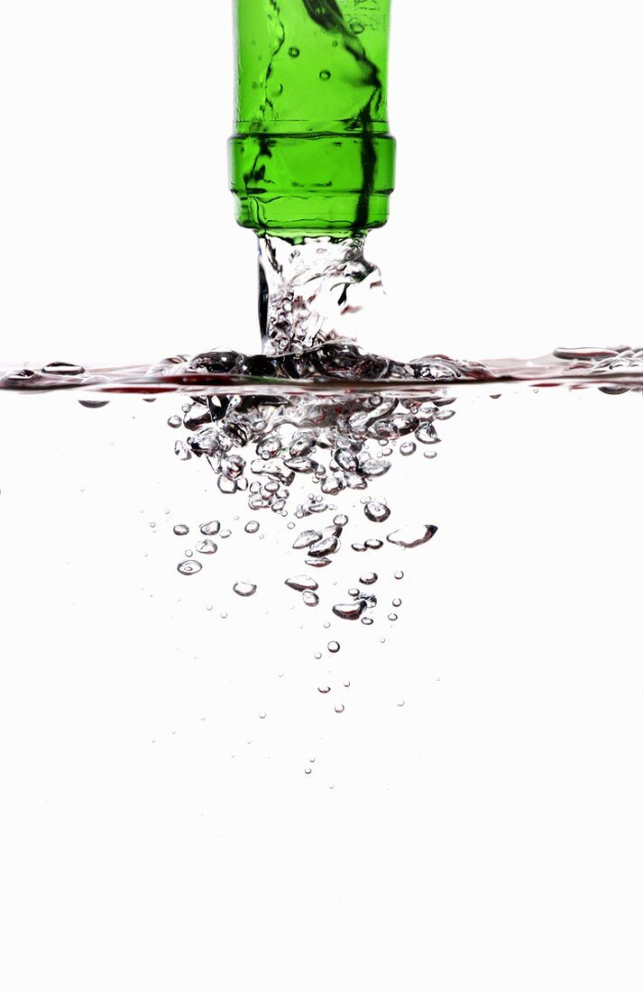 Water running out of a green bottle