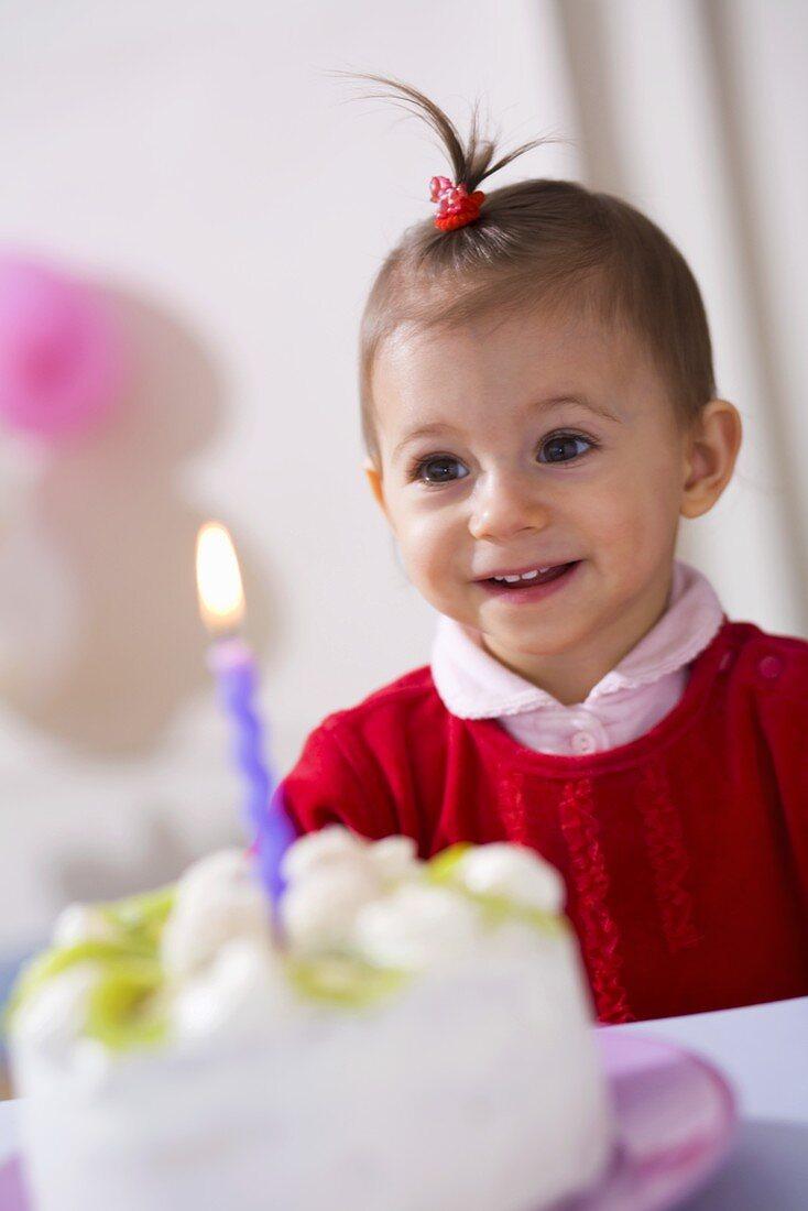 Small girl with kiwi coconut birthday cake