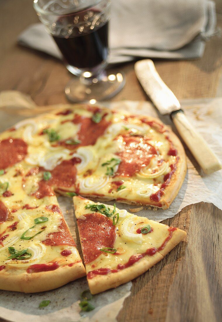 Salami pizza, a slice cut