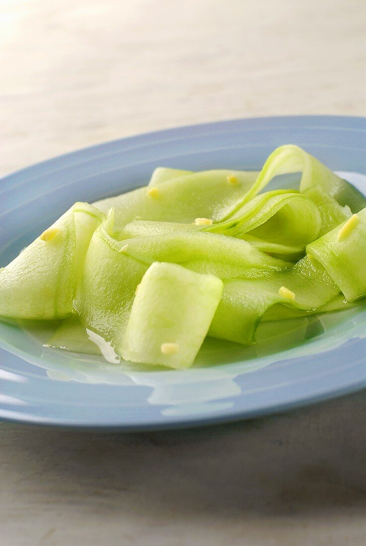 Marinating strips of cucumber