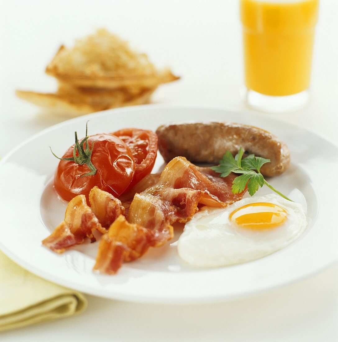 English breakfast: bacon, fried egg, sausage and tomato