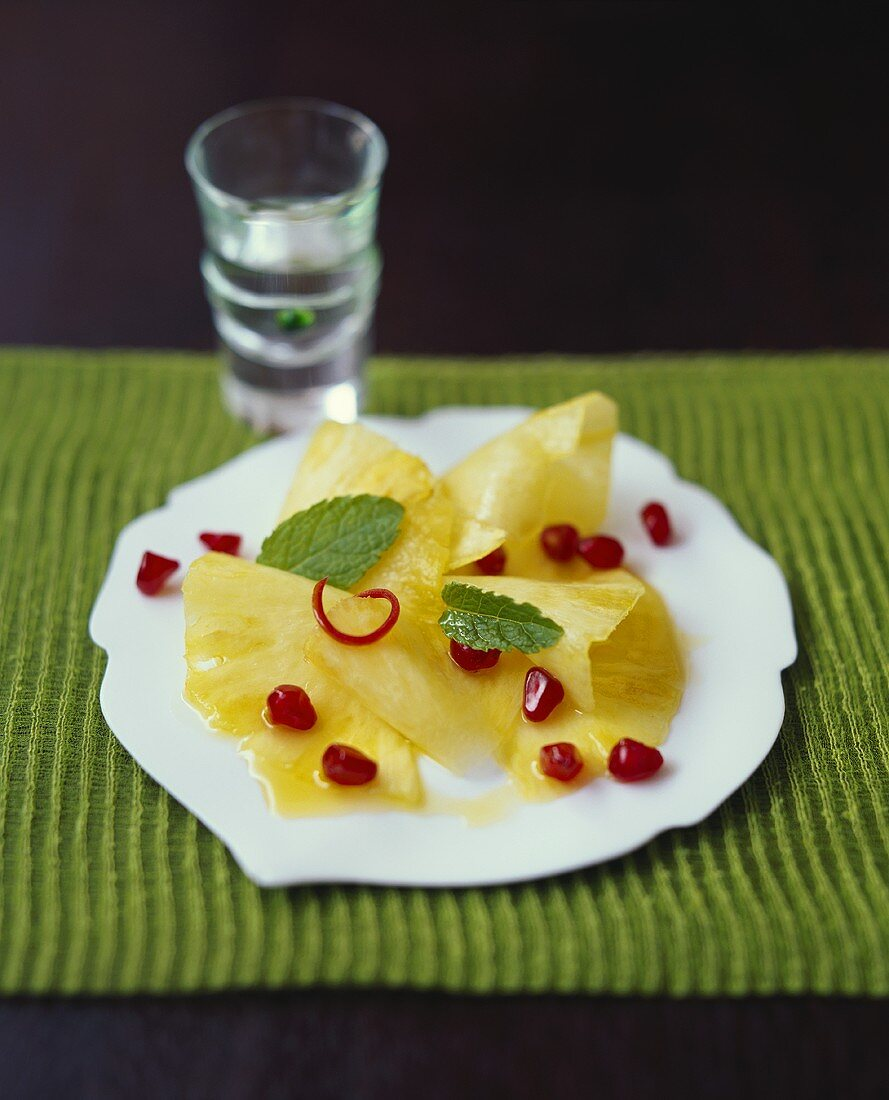Pineapple chunks with ginger and pomegranate seeds