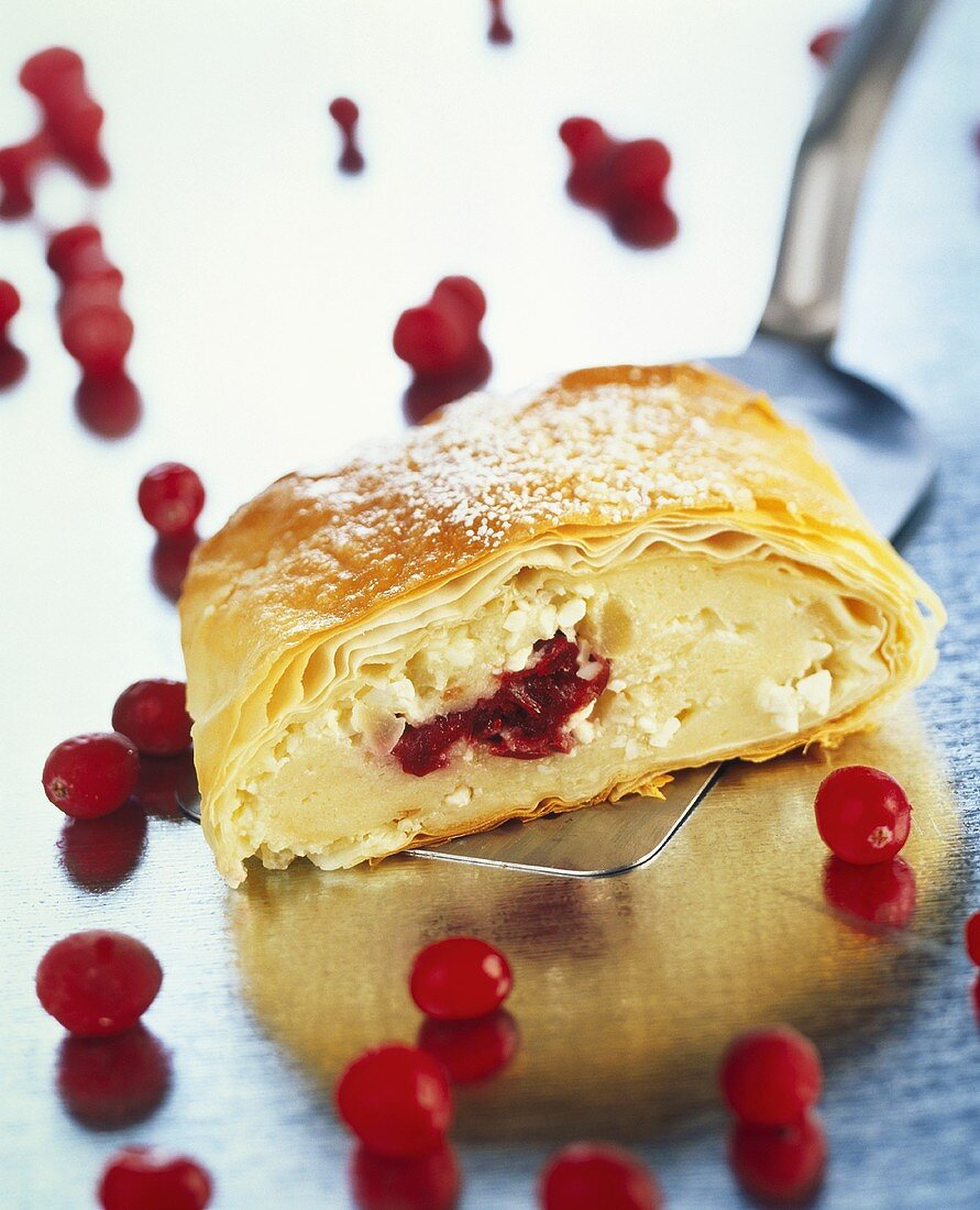 A piece of quark strudel with cranberries