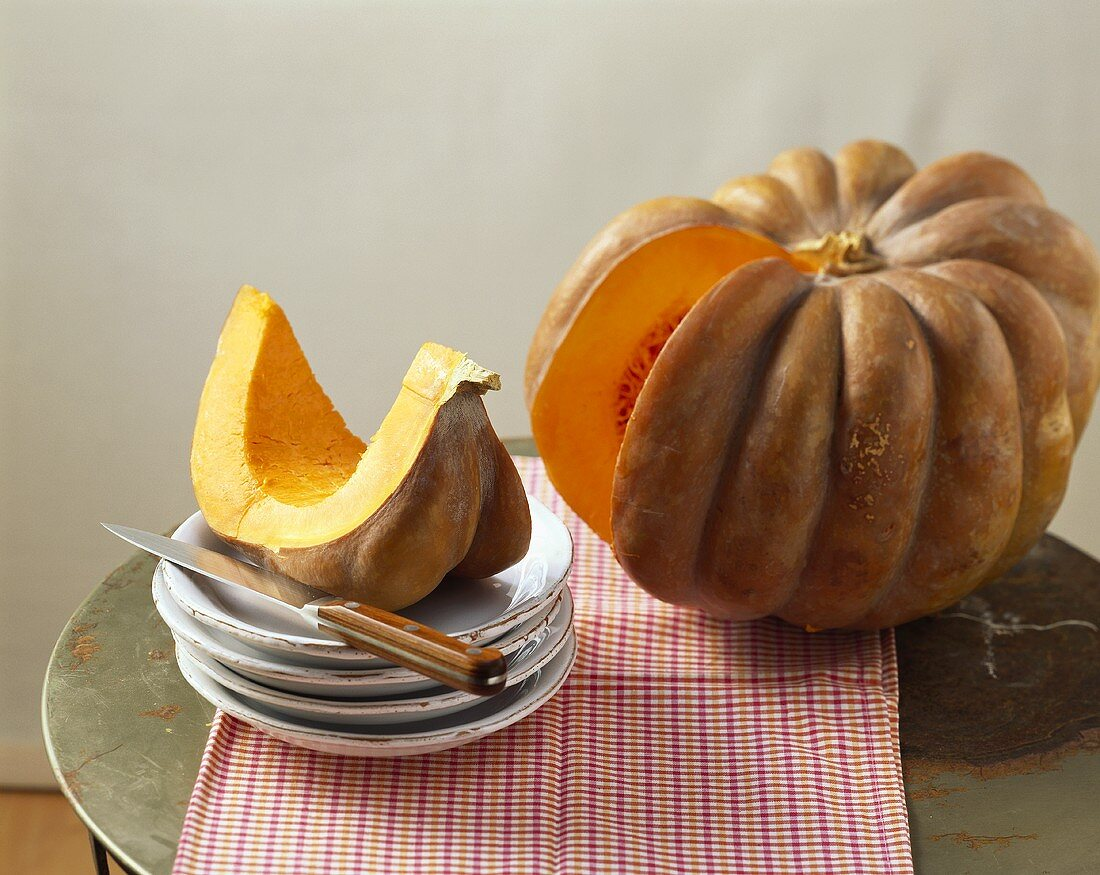 A winter squash with a piece cut out