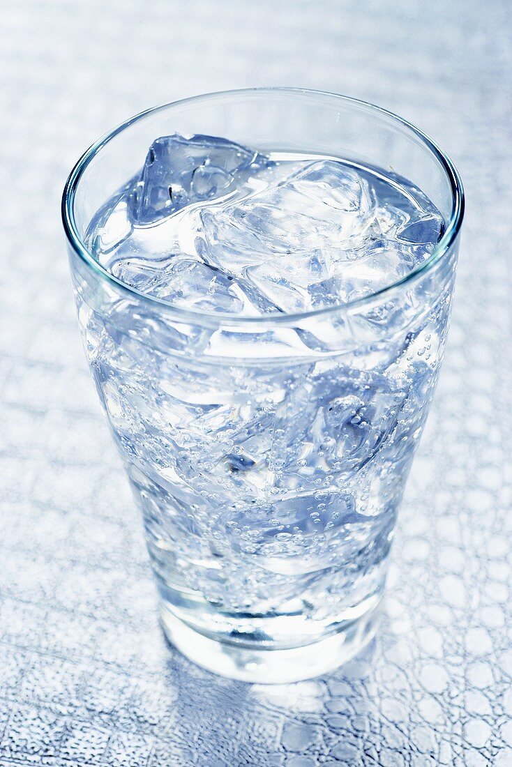 A glass of water with ice cubes