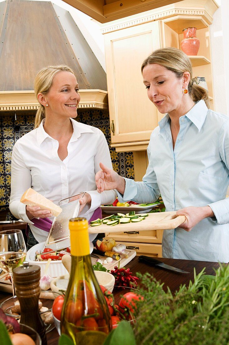 Two friends preparing food together