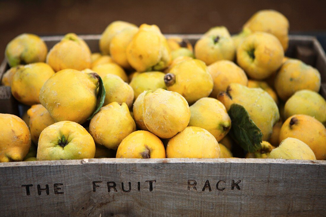 Quinces in a wooden crate